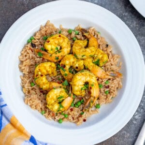 This Indian Style Shrimp is packed with flavor and served over a fragrant brown rice. It's easy to make and a totally satisfying dinner!