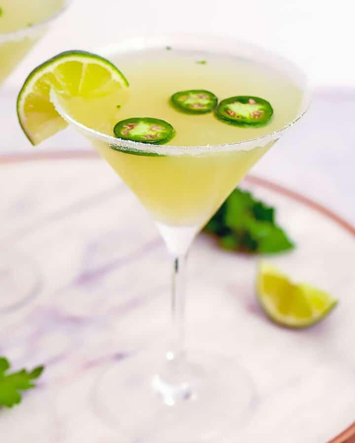 Jalapeño Parsley Sour Martini -- This Jalapeño Parsley Sour Martini brings a little bit of heat, a little bit of sweet, and a little bit of sour and is the ultimate jalapeño vodka martini | wearenotmartha.com