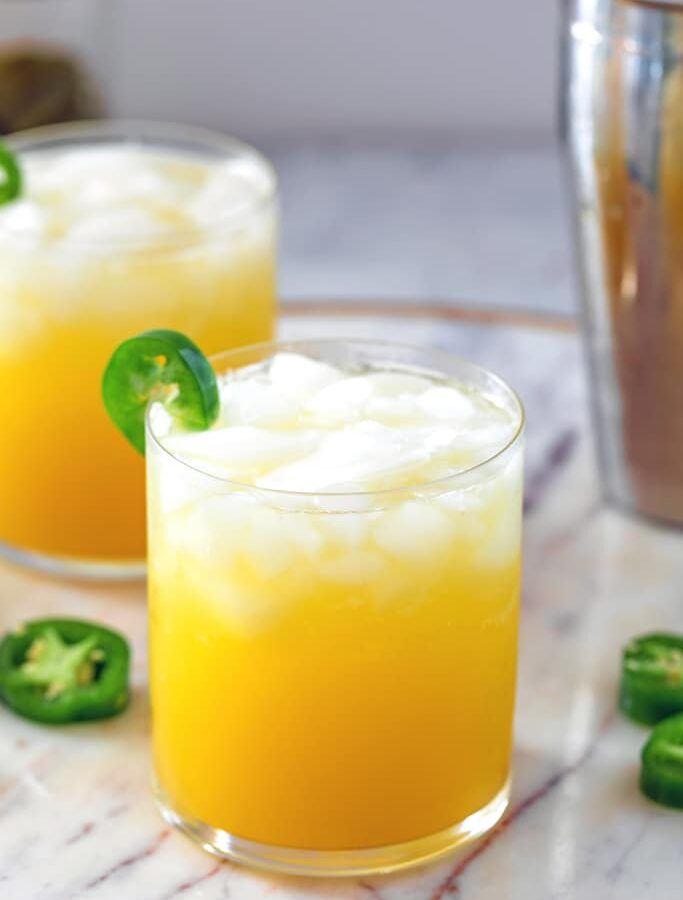 Jalapeño Orange Spritzer -- This Jalapeño Orange Spritzer is a perfectly refreshing cocktail with a nice little kick thanks to the jalapeño infused vodka. But don't worry; the level of spiciness can be easily controlled! | wearenotmartha.com