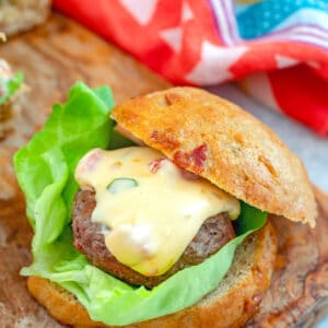Jalapeño Queso Burgers on Bacon Rolls -- These Jalapeño Queso Burgers are a dream come true! The spicy beef burgers are topped with jalapeño queso and served on homemade bacon rolls and will quickly become the best burger you've ever had | wearenotmartha.com