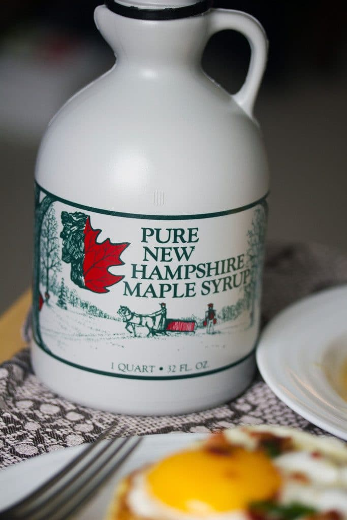 "An up close view of a bottle of ""Pure New Hampshire Maple Syrup"""