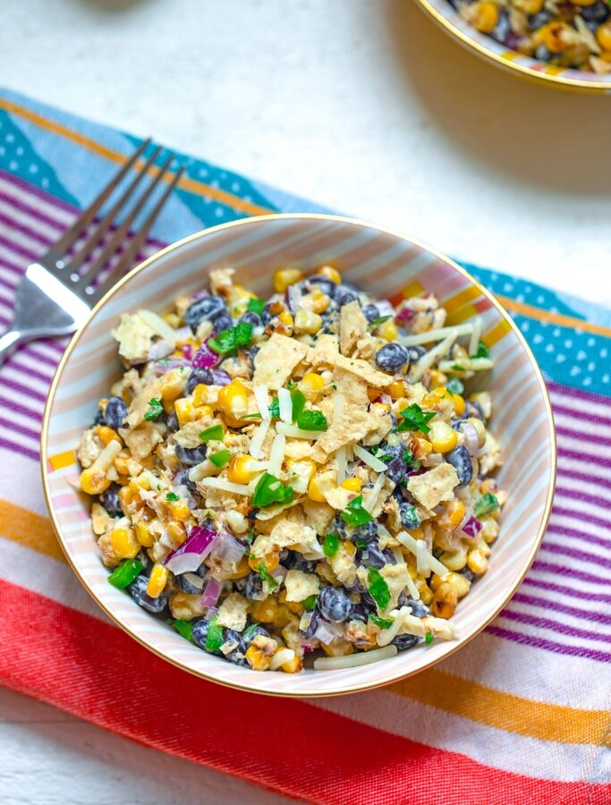 Jalapeño Cheddar Corn Salad -- This Jalapeño Cheddar Corn Salad mixes charred corn, black beans, red onion, jalapeño, and cheddar cheese tossed with Jalapeño Cheddar Heluva Good! Dip for a fabulous summer salad that's always a crowd-pleaser | wearenotmartha.com