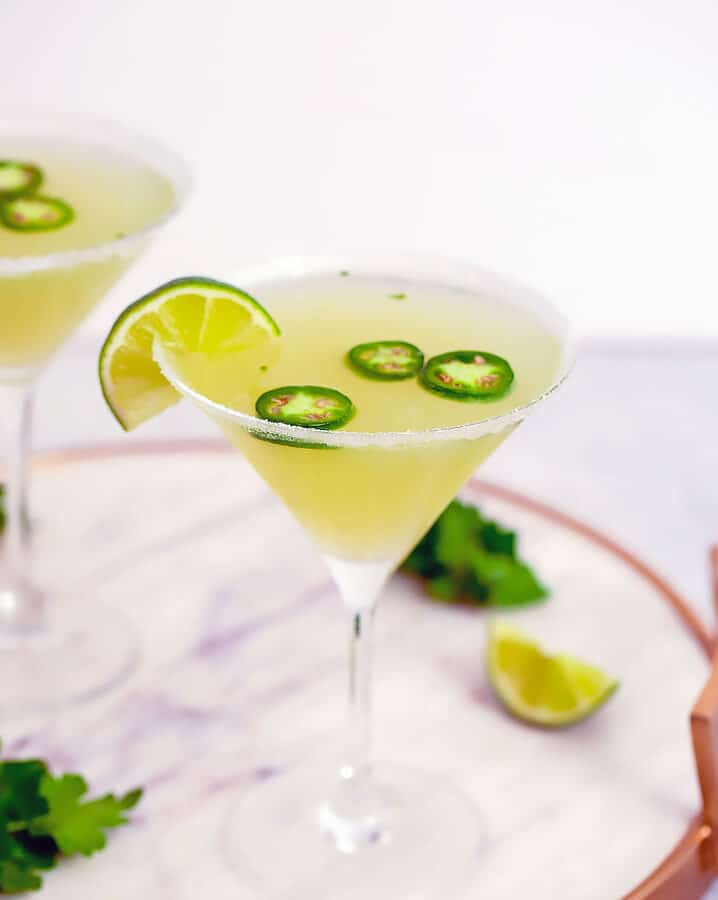 Jalapeño Parsley Sour Martini -- This Jalapeño Parsley Sour Martini brings a little bit of heat, a little bit of sweet, and a little bit of sour and is the ultimate jalapeño vodka martini. | wearenotmartha.com