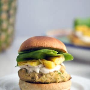 Jalapeño Tuna Burgers with Grilled Pineapple and Lemon Mayo -- Canned tuna doesn't have to mean boring old tuna sandwiches. This recipe for tropical-style Jalapeño Tuna Burgers with Grilled Pineapple and Lemon Mayo is likely to become a summertime staple | wearenotmartha.com