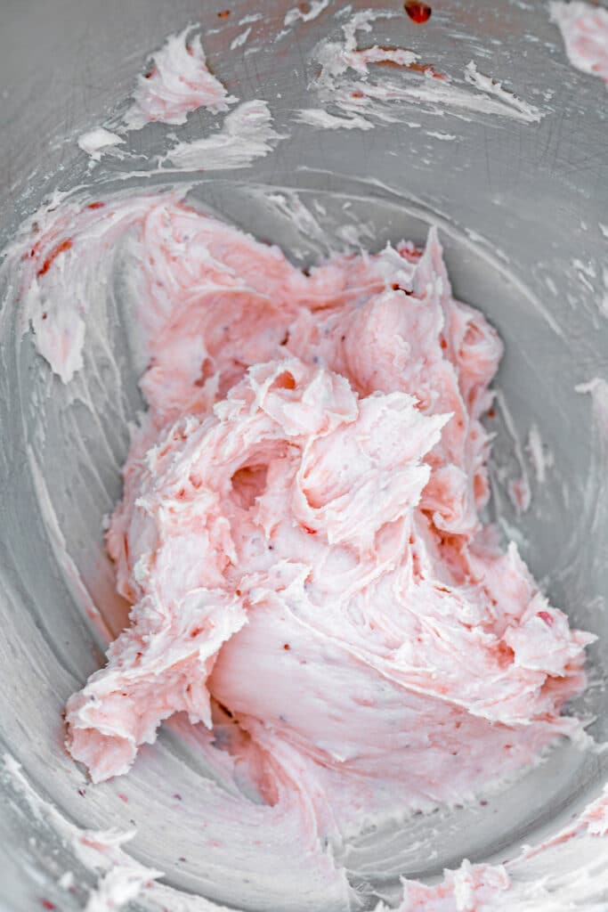 Overhead view of raspberry jelly buttercream in mixing bowl