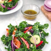 Kale Greek Salad -- Thanks to lots of fresh vegetables, kalamata olives, and feta cheese, a Greek salads is always delicious. But a Kale Greek Salad is both delicious and extra healthy! | wearenotmartha.com