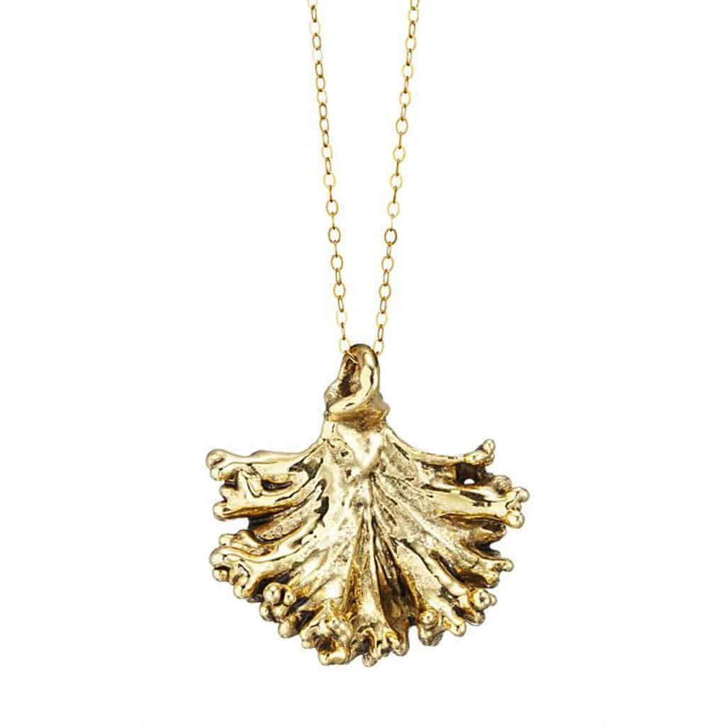Head on view of gold kale necklace on a gold chain