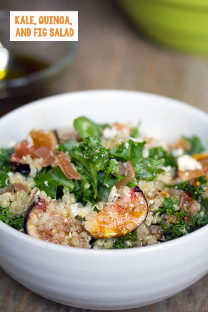 Head-on closeup view of lemony kale, quinoa, and fig salad in a white bowl with recipe title at top of image