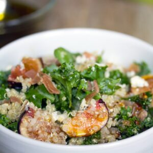 Lemony Kale, Quinoa, and Fig Salad -- This kale fig salad is tossed with prosciutto and gorgonzola and is satisfying enough to be enjoyed as a meal | wearenotmartha.com