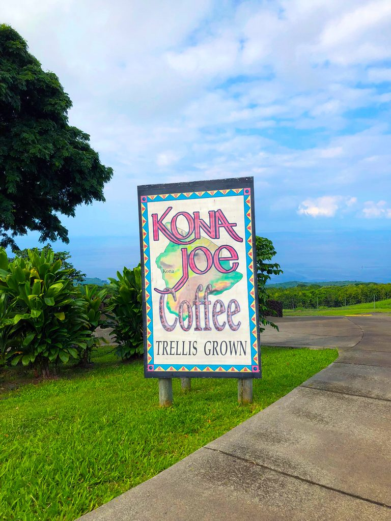 Entrance to Kona Joe's in Kona on the Big Island of Hawaii with a sign and blue sky background