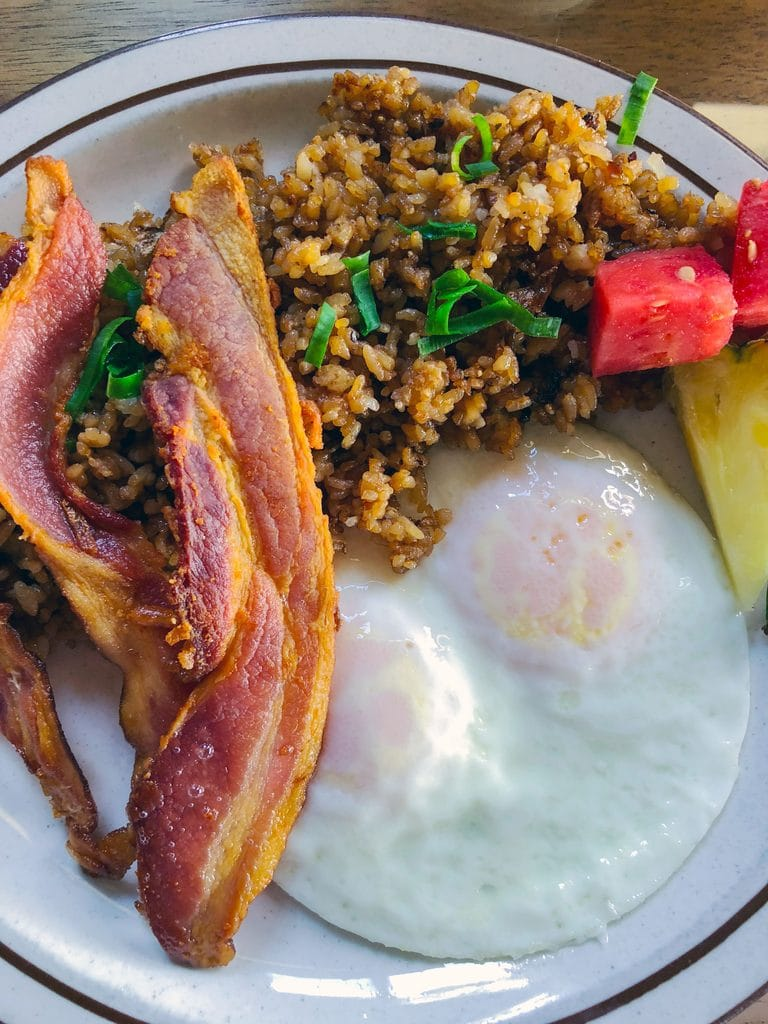 Eggs, bacon, rice, and fruit at Kula Sandalwoods in Maui