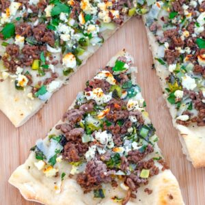 Lamb Mint Flatbread -- This Lamb Flatbread with Mint and Feta is easy to make with simple ingredients, but is filled with lots of delicious spring and summer flavors | wearenotmartha.com