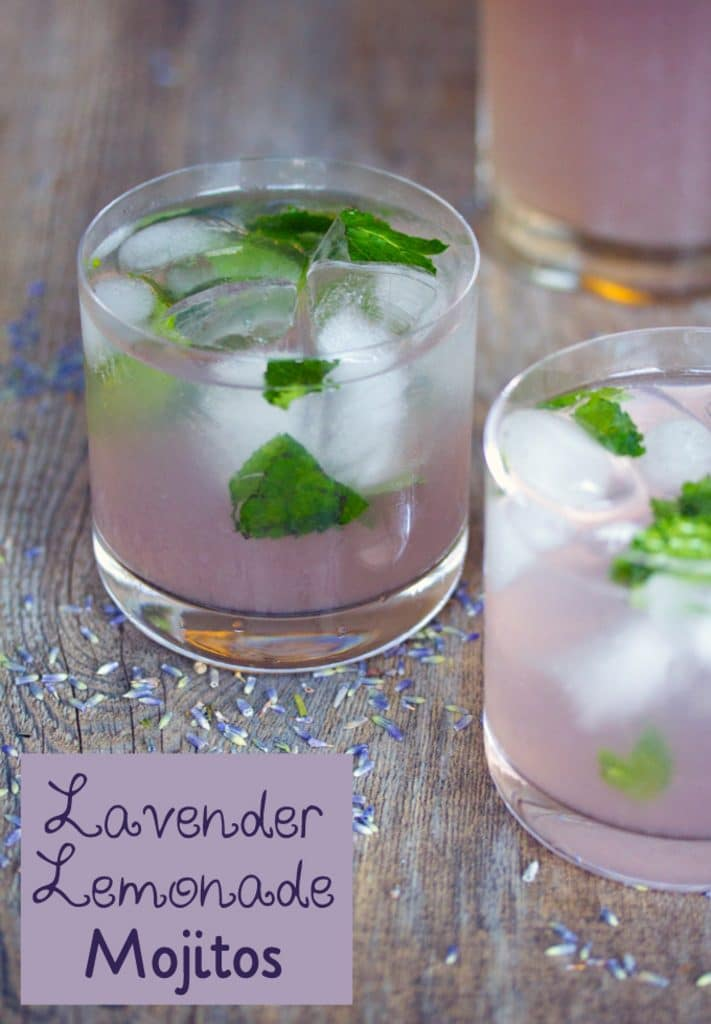 "Head-on view of lavender lemonade mojito on a wood surface with dried lavender and ""Lavender Lemonade Mojitos"" text on the bottom of photo"