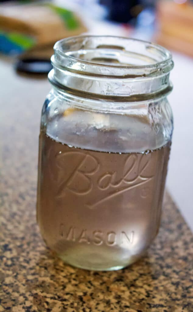 Mason jar filled with light purple lavender simple syrup
