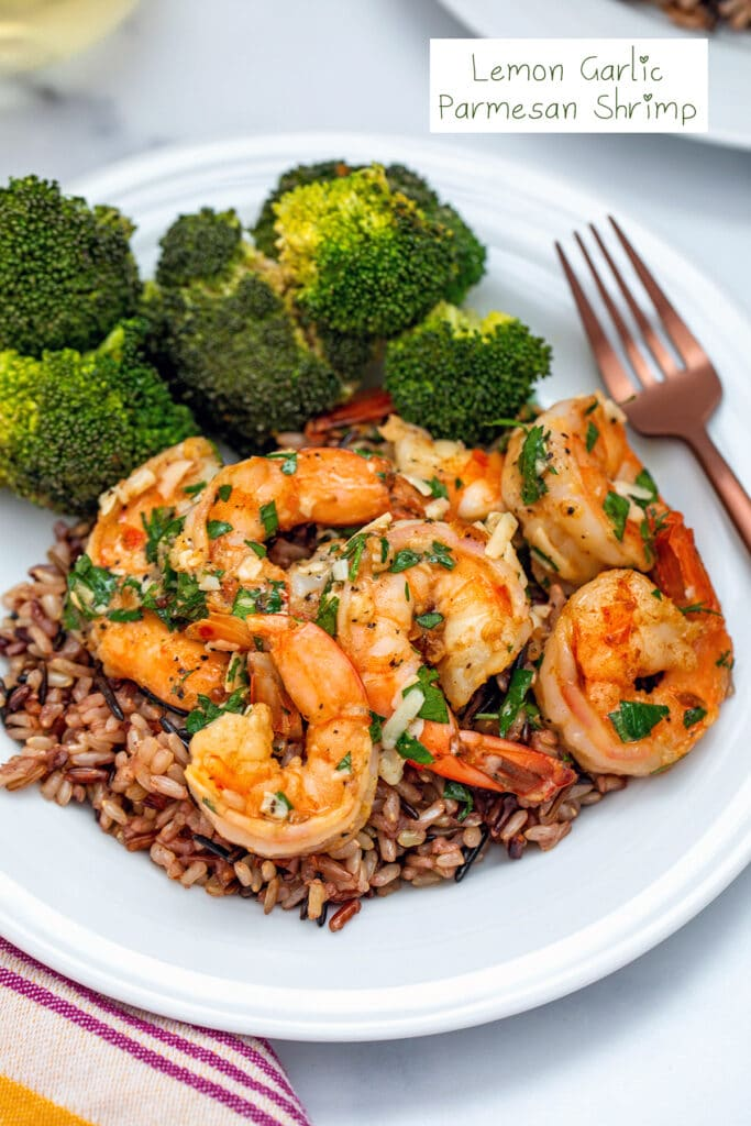 Lemon Garlic Parmesan Shrimp over a. bed of rice with a side of broccoli with recipe title at the top of image