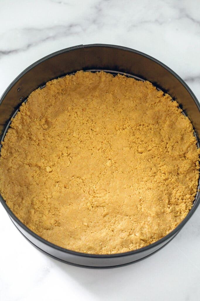Lemon Oreo Cookie crust in round springform pan