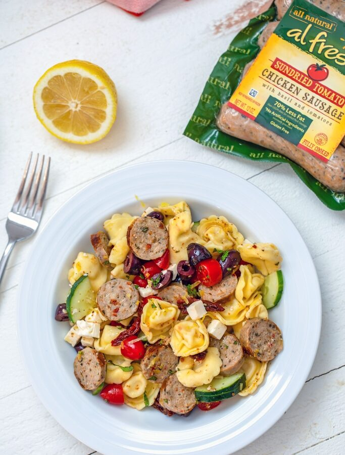 Lemon Tortellini Salad with Chicken Sausage -- This dish is incredibly easy to prepare and heartier than your typical pasta salad. It's perfect for a low-key summer dinner, but also makes an excellent dish to bring to a BBQ or summer party | wearenotmartha.com