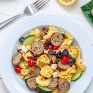 Lemon Tortellini Salad with Chicken Sausage -- This dish is incredibly easy to prepare and much heartier than your typical pasta salad. It's perfect for a low-key summer dinner, but also makes an excellent dish to bring to a BBQ or summer party | wearenotmartha.com