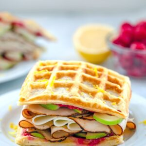 These Lemon Waffle Sandwiches are loaded with honey turkey, provolone cheese, and green apples, with a simple raspberry spread. They're perfect for enjoying during a late summer's picnic or any time of year!
