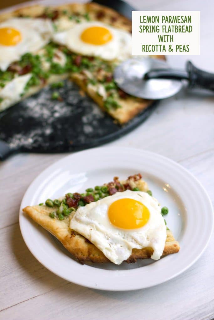 Head-on view of slice of lemon parmesan spring flatbread with ricotta, peas, capicola, and eggs on a white plate with rest of pizza and pizza cutter in background with recipe title at top