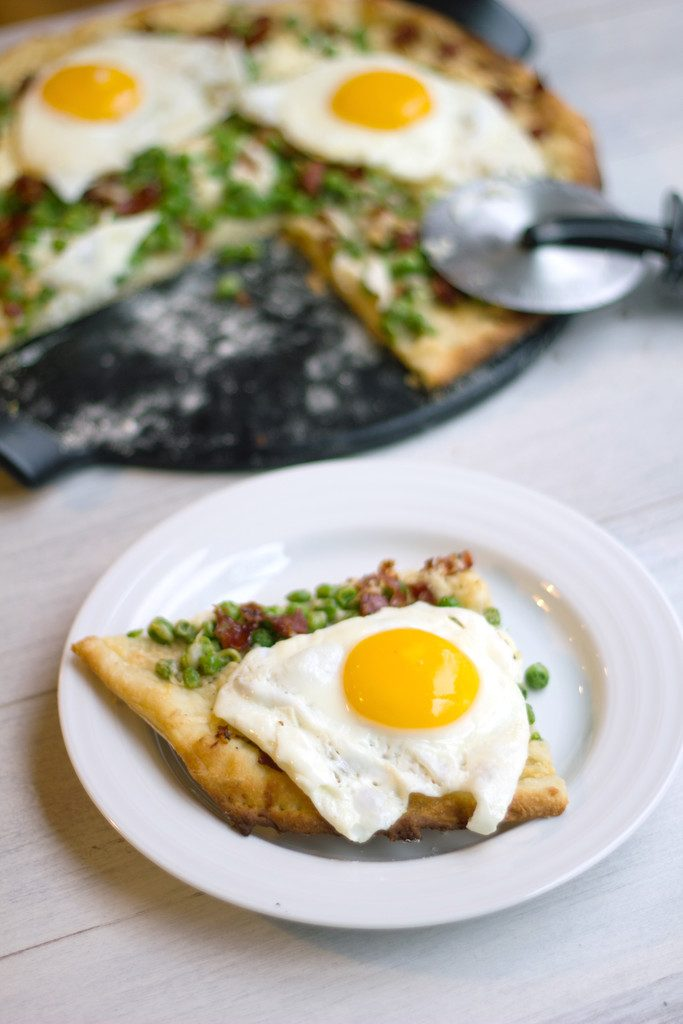 Parmesan Spring Flatbread with Ricotta and Peas: An easy weeknight dinner made better with an egg on top!  | Wearenotmartha.com