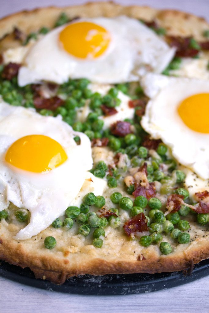 Lemon parmesan spring flatbread with sunnyside-up eggs added on top