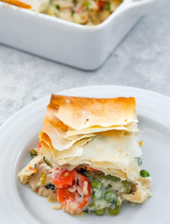 Lighter Chicken Pot Pie -- This Lighter Chicken Pot Pie is packed with all the good stuff and topped with a buttery phyllo dough crust. A little bit healthier than the original, but just as tasty! | wearenotmartha.com