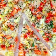Lobster Artichoke Flatbread -- Lobster is delicious right out of the shell, but this Lobster Artichoke Flatbread will make you realize that lobster is amazing on pizza, too! | wearenotmartha.com