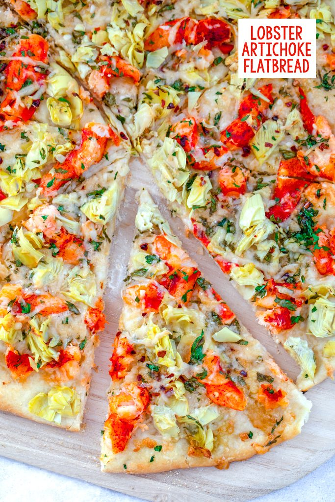 Overhead view of a lobster flatbread pizza with artichokes with a slice pulled out and recipe title at top