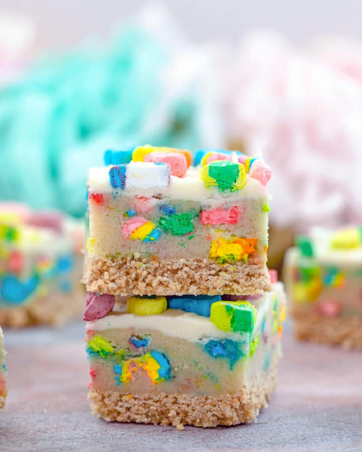 Lucky Charms Cookie Dough Bars -- These Lucky Charms Cookie Dough Bars are a magically delicious dessert consisting of three layers: a sweet and buttery cereal crust, a marshmallow packed cookie dough middle, and a simple buttercream frosting top | wearenotmartha.com #cookiedoughbars #luckycharms #cookiedough #stpatricksday