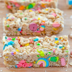 Head-on close-up of Lucky Charms granola bars on a board