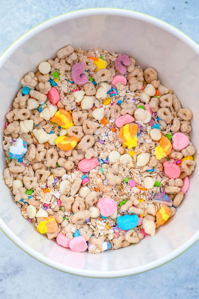 Overhead view of a bowl filled with Lucky Charms cereal mixed with quick cooking oats, white chocolate chips, and sprinkles
