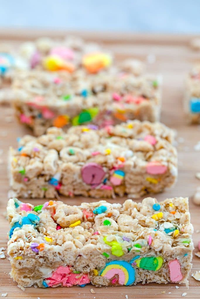 Overhead view of Lucky Charms granola bars lined up on a cutting board