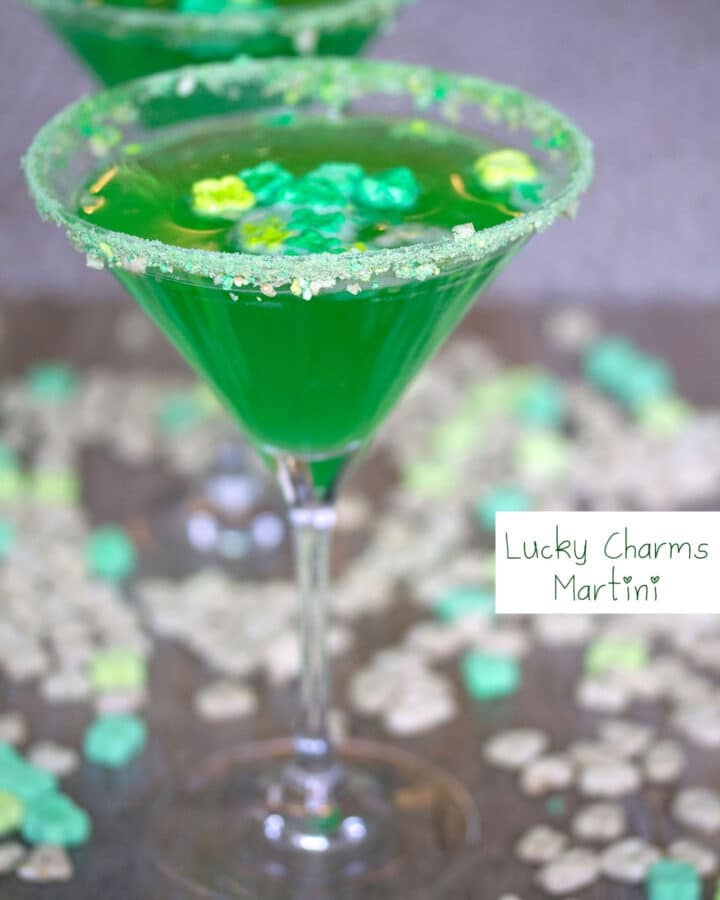 Head-on view of bright green Lucky Charms martini with cereal all around