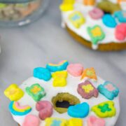 Lucky Charms Doughnuts -- You don't need a holiday to enjoy a bowl of Lucky Charms cereal or a Lucky Charms dessert, but these Lucky Charms Doughnuts are the perfect St. Patrick's Day treat! | wearenotmartha.com