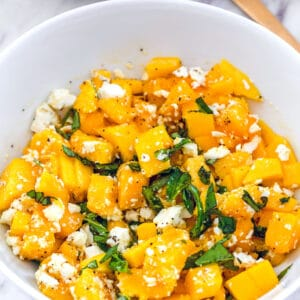 Mango and Feta Salad -- With just four simple ingredients, this Mango and Feta Salad is the stuff your summertime dreams are made of. It's sweet and salty and all things wonderful! | wearenotmartha.com