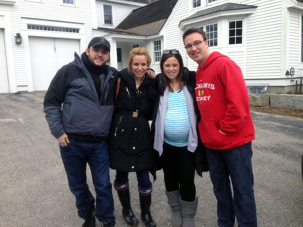 Chris, Sues, Beth, and Adam standing outside the house in New Hampshire where the sugar shack is
