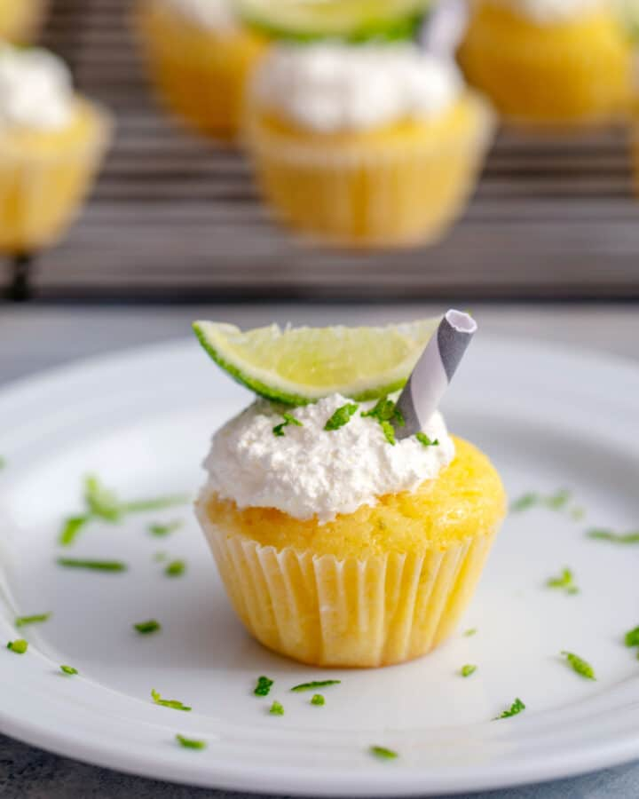Margarita Cupcakes -- These margarita cupcakes are full of lime flavor... and a little bit of tequila, too! They're easy to make as full-size or mini cupcakes and perfect for summer parties | wearenotmartha.com