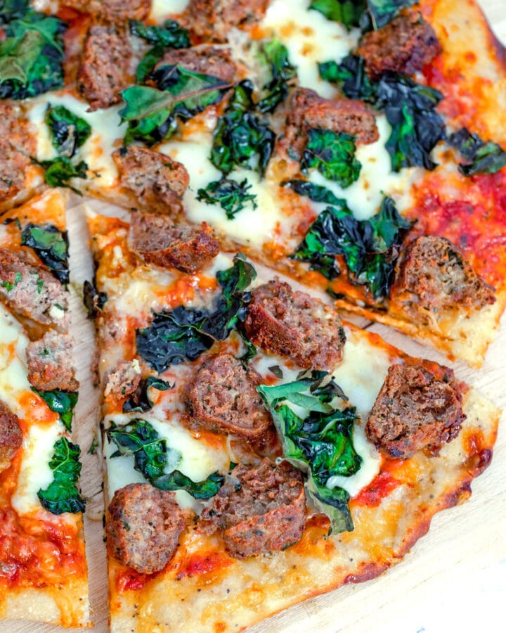 Meatball Flatbread with Parmesan Peppercorn Crust -- What could be better than a pizza topped with meatballs, cheese, and kale? This Meatball Flatbread also has a Parmesan Peppercorn Crust and is the perfect weeknight or weekend dinner! | wearenotmartha.com