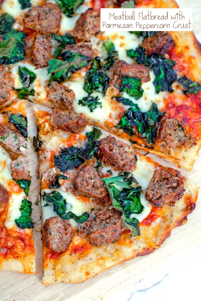 Overhead view of a slice of meatball flatbread with cheese and kale pulled out from the rest of the pizza with recipe title at top