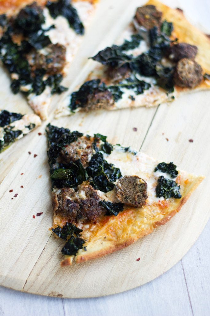 Meatball Pizza with Parmesan Peppercorn Crust -- Meatballs and kale make this flatbread a dreamy dinner | wearenotmartha.com