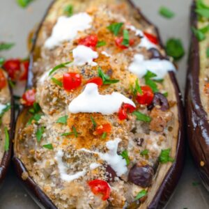"Mediterranean Turkey Stuffed Eggplant -- This Mediterranean Turkey Stuffed Eggplant is a deliciously creamy dish packed with ground turkey, Greek spices, kalamata olives, feta cheese, tomatoes, and Hood Sour Cream. Grab a fork and dig in and don't forget to eat the ""bowl"" 