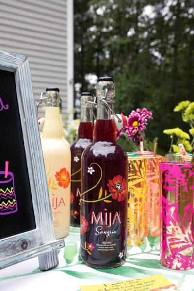DIY Sangria Bar -- Use Mija Sangria, fresh fruit, and some fun accessories for your own fun summer sangria bar! | wearenotmartha.com
