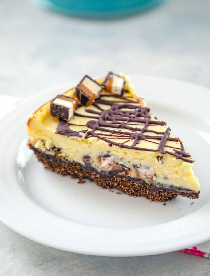 Milky Way Midnight Cheesecake -- This Milky Way Cheesecake is made with Milky Way Midnight Dark Chocolate bars for an extra decadent cheesecake that tastes like it came straight from a bakery | wearenotmartha.com