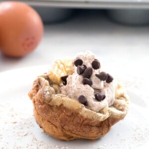 Mini Cinnamon Chocolate Chip German Pancakes with Cinnamon Whipped Cream -- bite-sized brunch made in a muffin tin! | wearenotmartha.com