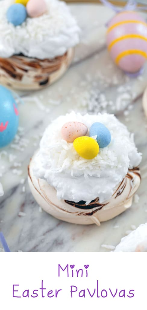 Mini Easter Pavlovas -- These Mini Easter Pavlovas have a chocolate swirled pavlova base and are topped with coconut whipped cream, shredded coconut, and Cadbury Mini Eggs. They make for a fun and delicious Easter dessert, but the mini pavlova base can be made any time of year | wearenotmartha.com #pavlovas #easter #coconut #cadburyeggs