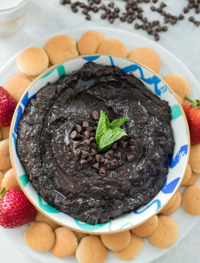 Mint Chocolate Hummus -- There's no reason to be skeptical of chocolate hummus! This Mint Chocolate Hummus can be served with fresh fruit or cookies and makes the perfect creamy dessert dip. Nobody will even guess that it's made with chickpeas   wearenotmartha.com