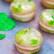 Mint Macarons with Baileys Buttercream -- These Mint Macarons with Baileys Buttercream are a magically fun St. Patrick's Day party treat, but are also delicious any time of year! | wearenotmartha.com #macarons #mint #stpatricksday #baileys