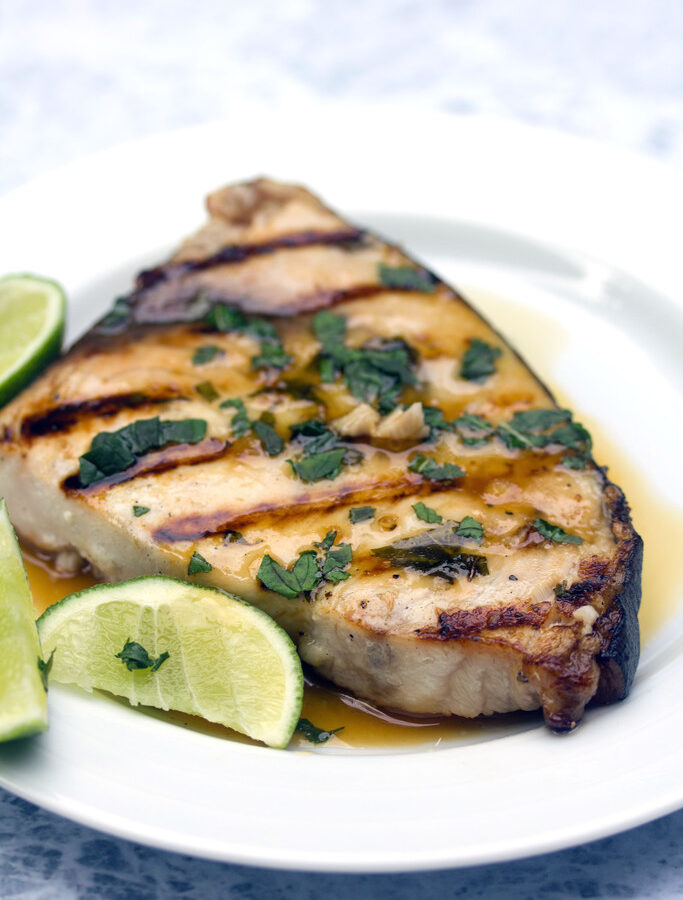 Grilled Mojito Swordfish -- Your favorite summer cocktail in fish form? This grilled Mojito Swordfish has all the flavors of the classic mojito and is so quick and easy to prepare | wearenotmartha.com