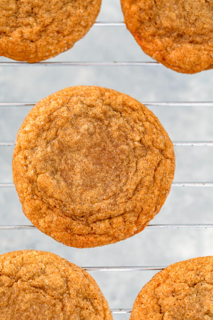 Overhead view of baked molasses ginger cookies on baking rack